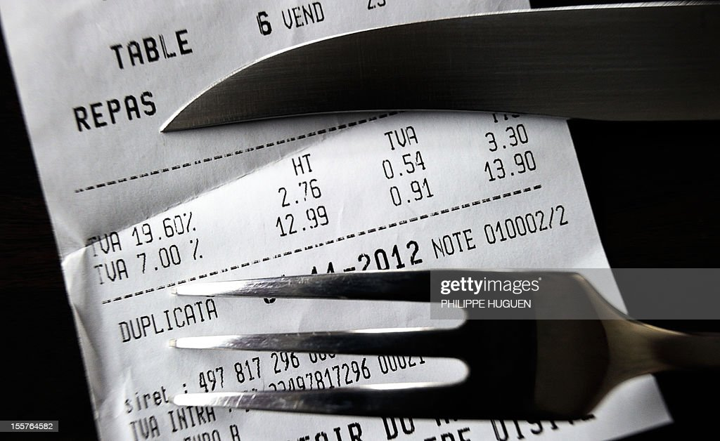 A picture taken on November 8, 2012 in a restaurant in Lille shows a fork and knife set up on a bill with the 19,60 percent value added tax (VAT), and the 7 percent VAT rate. The government announced on November 6, 2012 plans to increase VAT from 19,60% to 20% which is applied to alcoholic drinks sold in bars, cafes and restaurants. The move to increase the rate of value added tax (VAT) charged on restaurant food and hotel accommodation from seven to 10 percent was dubbed 'brutal' by the trade with representative bodies warning it will cost tens of thousands of jobs.