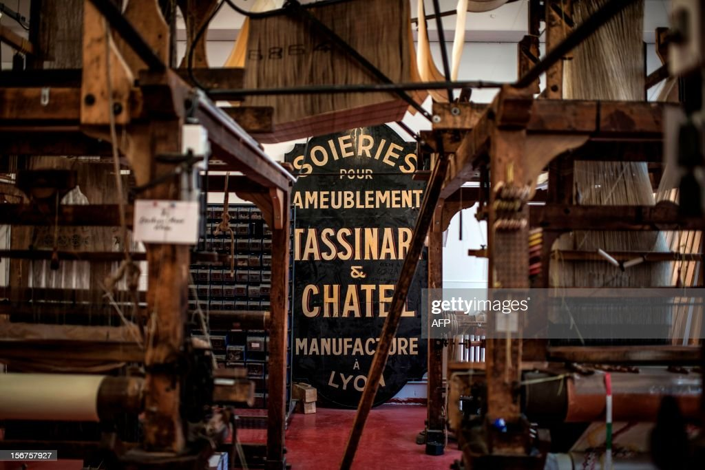 BOUILLON - A picture taken on November 8, 2012 shows weaving looms at the Tassinari & Chatel silk manufacture in Lyon. Founded in 1865, Tassinari & Chatel produces furnishing fabrics, specialising in the high-end and luxury markets. AFP PHOTO / JEFF PACHOUD
