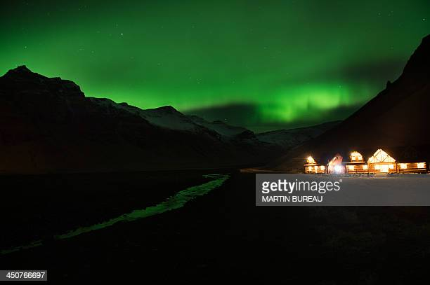 Picture taken on November 8 2013 shows northern lights or aurora borealis near the village of Vik in southern Iceland AFP PHOTO / MARTIN BUREAU