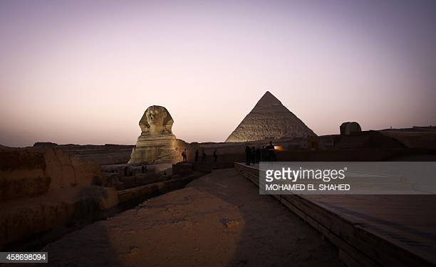 A picture taken on November 9 shows the Sphinx and the pyramid of Khafre in Giza on the outskirts of Cairo The Egyptian Antiquities Ministry restored...