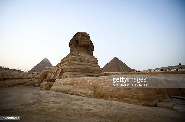 A picture taken on November 9 shows the sphinx flanked by the pyramids of Menkaure and Khafre in Giza on the outskirts of Cairo The Egyptian...