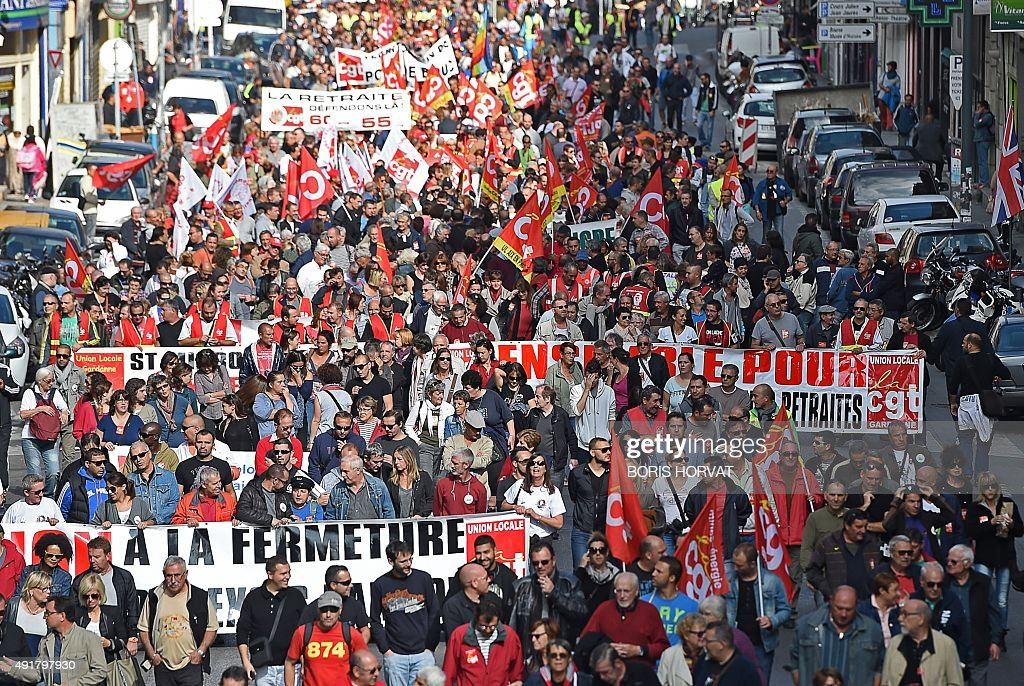 A picture taken on Occtober 8 2015 in Marseille shows an aerial view of demonstrators waving CGT union flags during a National Action Day organised...
