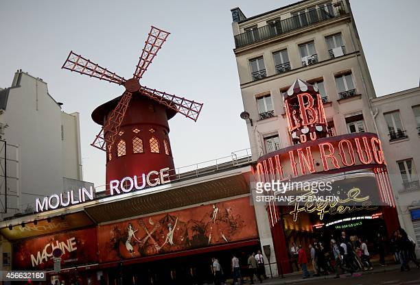 A picture taken on October 1 2014 shows the outside of the Moulin Rouge cabaret in Paris Cradle of French Cancan immortalized by Toulouse Lautrec's...