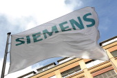 FILES Picture taken on October 12 2011 shows a flag with the logo of the German industrial giant Siemens AG at the historic construction plant German...
