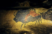 A picture taken on October 12 2012 shows a facsimile of a painting from the Lascaux caves as part of the 'Lascaux III' travelling exhibition in...