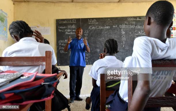 A picture taken on October 12 2017 shows a teacher giving a lesson at the Cecelia Dunbar Public school in the city of Freeman Reserved north of...