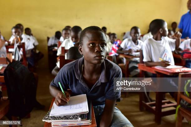 A picture taken on October 12 2017 shows pupils attending a class at the Cecelia Dunbar Public school in the city of Freeman Reserved north of...