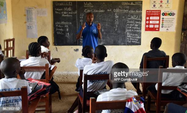 A picture taken on October 12 2017 shows pupils attending a lesson at the Cecelia Dunbar Public school in the city of Freeman Reserved north of...