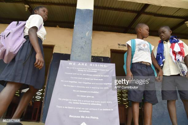 A picture taken on October 12 2017 shows pupils standing outside the Cecelia Dunbar Public school in the city of Freeman Reserved north of Monrovia /...