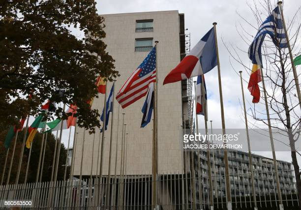 A picture taken on October 12 2017 shows the flags flying in front of the United Nations Educational Scientific and Cultural Organisation...
