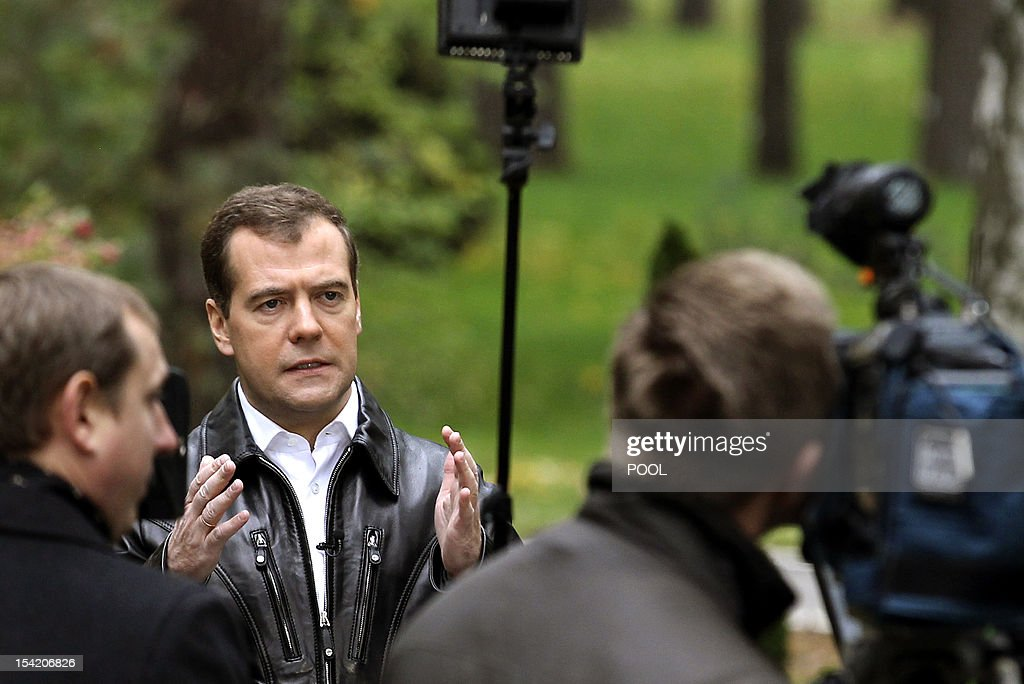 A picture taken on October 12, 2012, shows Russia's Prime Minister Dmitry Medvedev recording a message on his video blog somewhere in an undisclosed location in Moscow region. Russia plans to adopt a sweeping anti-smoking bill this month in a bid to halve the number of smokers in the country, Medvedev made the announcement on his video blog, which was released today.