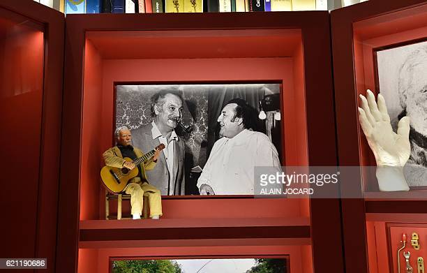 A picture taken on October 13 2016 shows a portrait of French comedian Raymond Devos with French singer Georges Brassens at his house in...