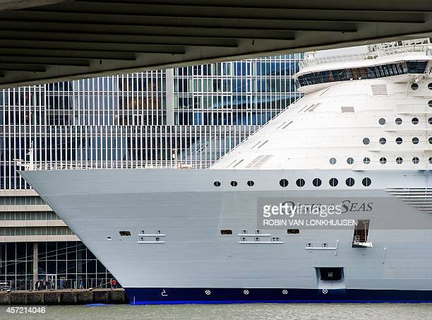 A picture taken on October 14 2014 shows the world's largest cruise ship 'Oasis of the Seas' anchored in the Rotterdam harbour The owners had to pay...