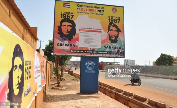 A picture taken on October 14 2017 in a street of Ouagadougou shows a poster celebrating former President Thomas Sankara known as 'Africa's Che...