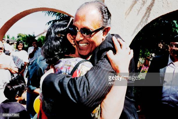 In this file picture taken on October 15 1989 antiapartheid activist Ahmed Kathrada is embraced as he arrives home in Lenasia following his release...