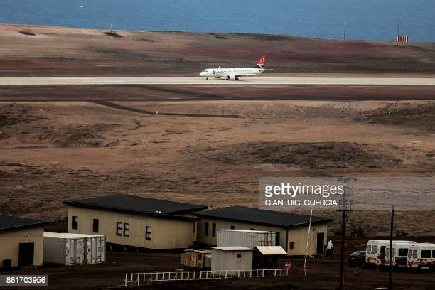 A picture taken on October 15 2017 shows the first Inaugural Commercial plane from Johannesburg before its take off at the newly built Saint Helena...