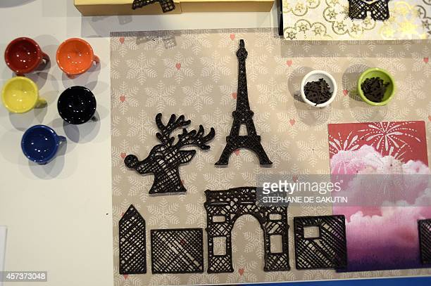A picture taken on October 16 2014 shows 3D printed chocolate at the 3D Printshow exhibition in Paris AFP PHOTO / STEPHANE DE SAKUTIN