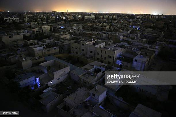 A picture taken on October 16 2015 shows a general night view of the rebelheld area of Douma east of the Syrian capital Damascus / AFP / SAMEER...