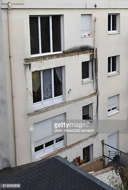 A picture taken on October 16 2016 shows debris from balconies in the courtyard of a building where four people were killed and several others...