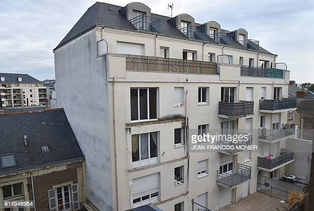 A picture taken on October 16 2016 shows the rear side of a building in which four people were killed and several others injured after a balcony...
