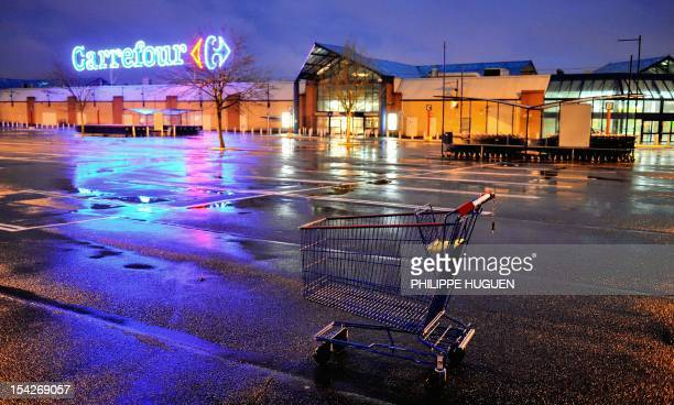 A picture taken on October 17 2012 shows a shopping trolley outside an hypermarket store of French retail giant Carrefour in Douai northern France...