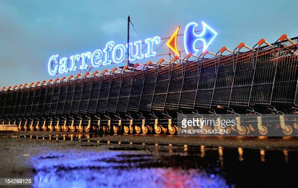 A picture taken on October 17 2012 shows shopping trolleys outside an hypermarket store of French retail giant Carrefour in Douai northern France AFP...