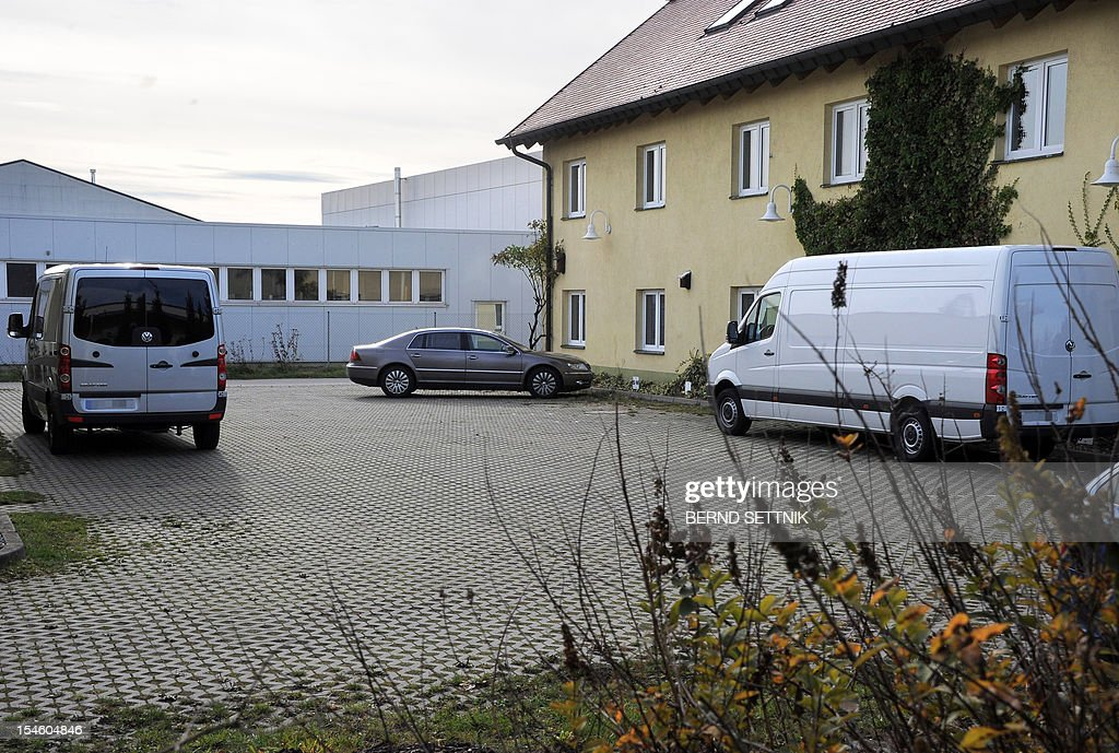 Picture taken on October 17, 2012 shows vans standing on the courtyard of a funeral parlour in Hoppegarten, east of the German capital Berlin and 70 kilometres (45 miles) from the Polish border. Polish police said on October 23, 2012 they had recovered 12 bodies that went missing when a van carrying coffins to a crematorium was stolen on October 15, 2012.