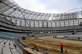 A picture taken on October 17 2014 shows men working inside the National Stadium in Baku The First European Games will take place in Baku from June...