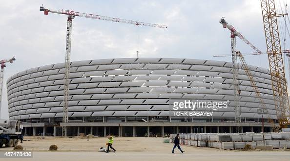 A picture taken on October 17 2014 shows people walking outside the National Stadium in Baku The First European Games will take place in Baku from...