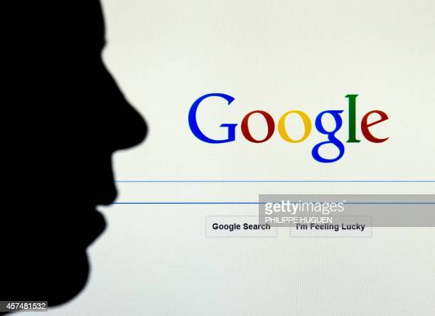 A picture taken on October 17 2017 in Lille shows a figue in front of the Google internet homepage AFP PHOTO / PHILIPPE HUGUEN