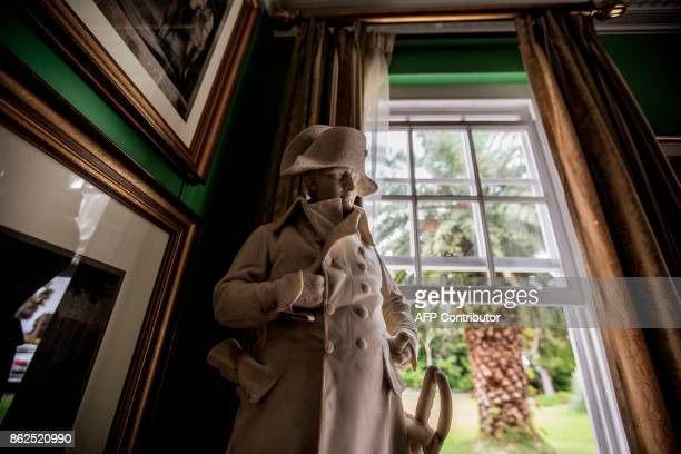 A picture taken on October 17 2017 shows a miniature statue of Napoleon in one of the Generals House room in the Napoleon House compound of his last...