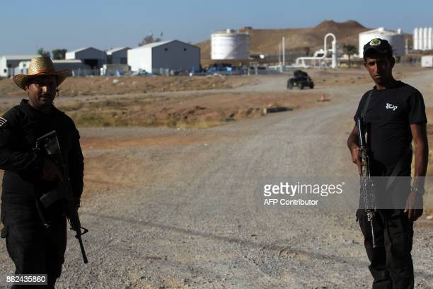 A picture taken on October 17 2017 shows Iraqi forces standing guard at the Havana oil field west of the multiethnic northern Iraqi city of Kirkuk...