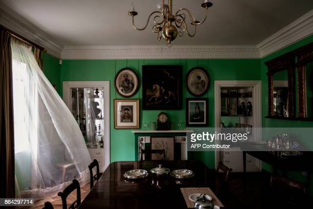 A picture taken on October 17 2017 shows the general house room decorated with miniature and paintings in the Napoleon House compound in Longwood on...