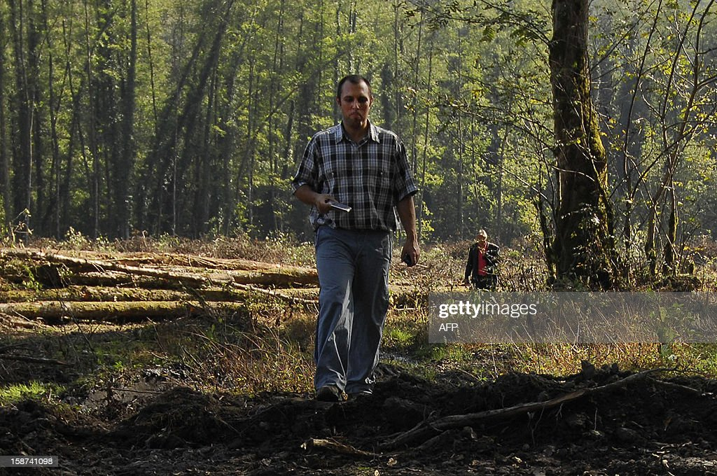A picture taken on October 17, 2009, shows Suren Gazaryan of the Environmental Watch on North Caucasus, walking in forest, close to the 2014 Olympics construction outside the black Sea resort of Sochi. Gazaryan is only one of several Russian activists who decided to leave the country after facing prosecution and possible jailtime following Vladimir Putin's reelection to the historic third term in May.