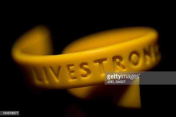 A picture taken on October 18 2012 in Paris shows a broken Livestrong wristband a yellow silicone gel bracelet launched as a fundraising item for the...