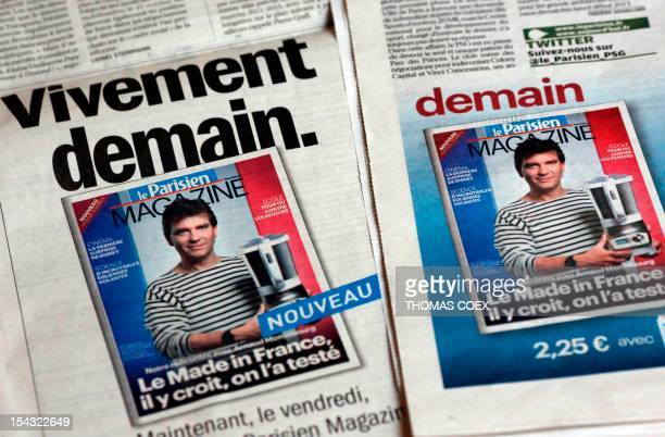 STORY A picture taken on October 18 2012 shows an image of French Minister for Industrial Renewal Arnaud Montebourg wearing a mariniere shirt in an...