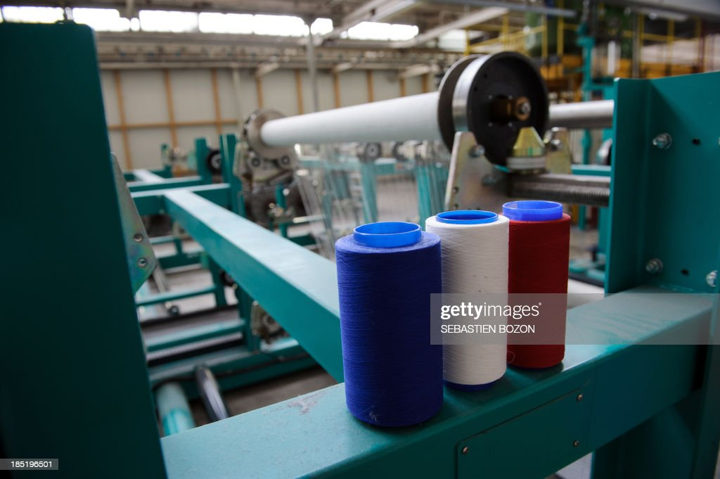 A picture taken on October 18, 2013 in Hirsingue shows string at the Virtuose factory, a textil manufacture. AFP PHOTO / SEBASTIEN BOZON