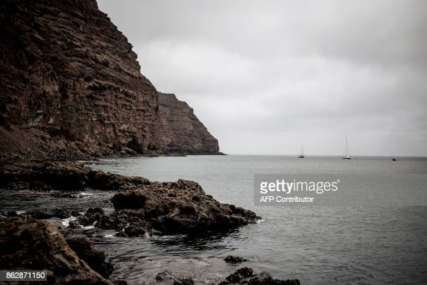 A picture taken on October 18 2017 shows boats and sailing yachts off the coast of the Jamestown Jetty in the British Overseas Territory of Saint...