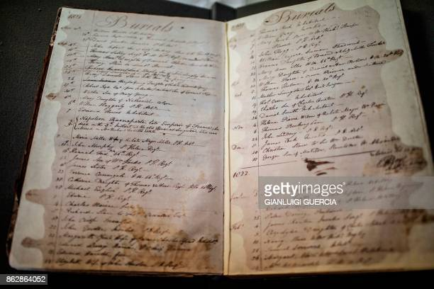 A picture taken on October 18 2017 shows the burial registration of the last French Emperor Napoleon at the burial register of the Saint Helena...