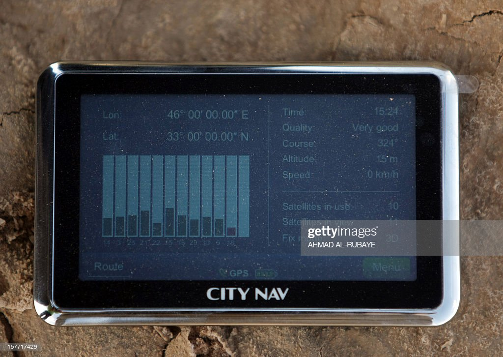A picture taken on October 18, 2012, shows coordinates on a GPS receiver Ruba Husari used to find her sixth confluence point several kilometres (miles) from the village of Qalaat Muzeibleh, near Badra, south east of Baghdad. The spot marked the exact geographic intersection of a latitude and longitude point -- 33 degrees north and 46 degrees east -- one of several in Iraq and around the world that adventurous travellers are looking to document as part of an Internet-based project.