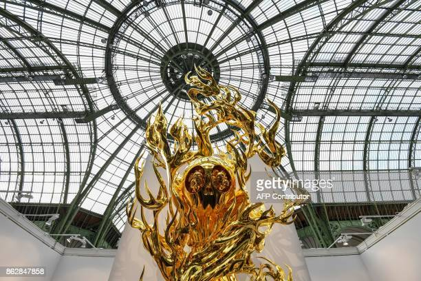 A picture taken on October 189 2017 shows 'Flame of desireGold 20132015' by Japanese artist Takashi Murakami during the Paris International...