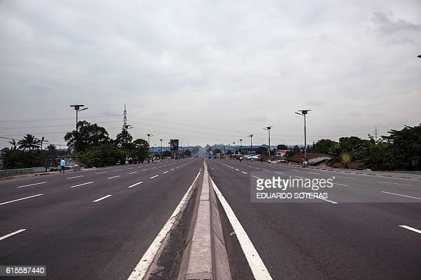 A picture taken on October 19 2016 shows a deserted avenue as the Congolese capital Kinshasa was gripped by a strike called 'Villes mortes' on...