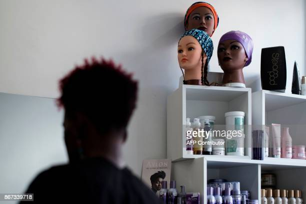 A picture taken on October 19 2017 shows a mannequin heading are displayed at a hairdressing salon specialized in afro natural hair care of in...