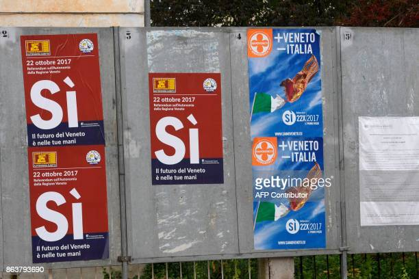 A picture taken on October 20 2017 in Salzano Veneto shows posters announcing a referendum in Italy's northerneast region of Veneto to request more...