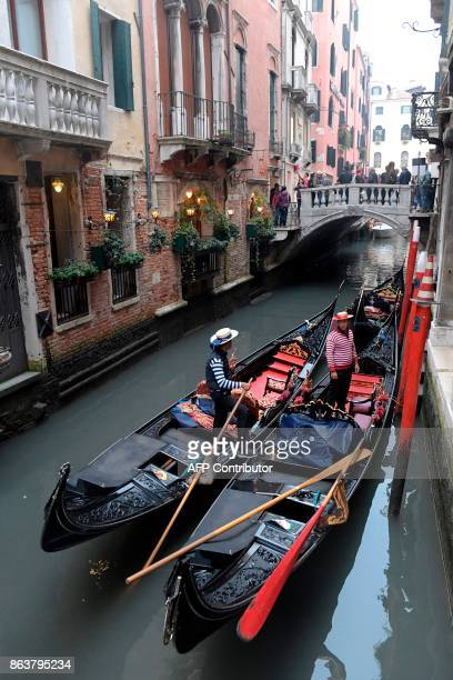 A picture taken on October 20 2017 in Venice shows Gondolas in one of the canals A referendum will be held on October 22 2017 in the Italian regions...