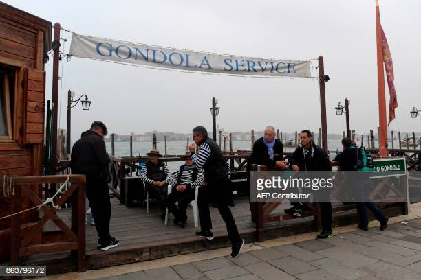 A picture taken on October 20 2017 in Venice shows Gondoleros close to St Marks square A referendum will be held on October 22 2017 in the Italian...