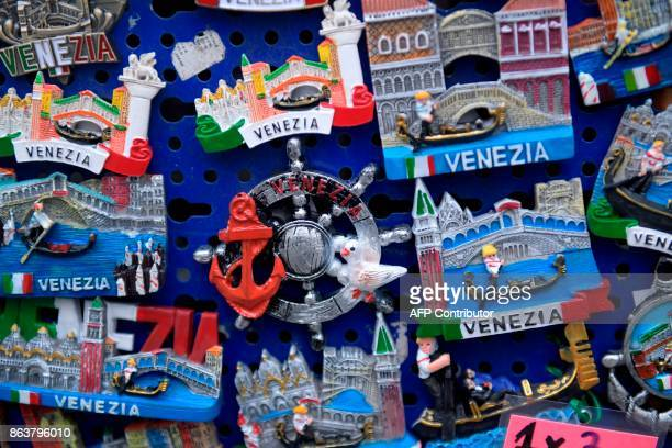 A picture taken on October 20 2017 in Venice shows souvenirs A referendum will be held on October 22 2017 in the Italian regions of Lombardy and...