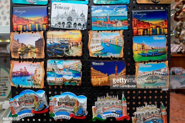 A picture taken on October 20 2017 in Venice shows souvenirs of Venezia in a comercial street close to the Rialto bridge at the Canal Grande A...