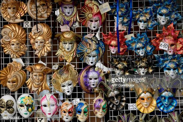 A picture taken on October 20 2017 in Venice shows Venetian mask for sale A referendum will be held on October 22 2017 in the Italian regions of...