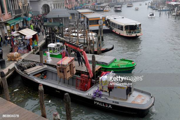 A picture taken on October 20 2017 shows a merchandise boat at the Canal Grande A referendum will be held on October 22 2017 in the Italian regions...